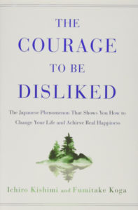 """The cover of the book """"The Courage to Be Disliked"""" by Ichiro Kishimi."""