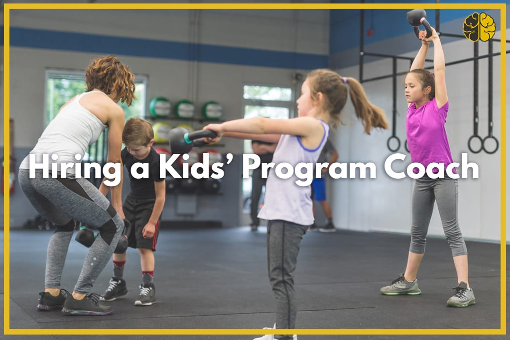 A coach teaching kids proper form with kettle bells
