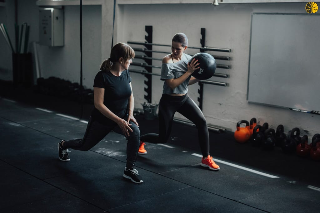 A trainer working out with her client - 50 percent personal training
