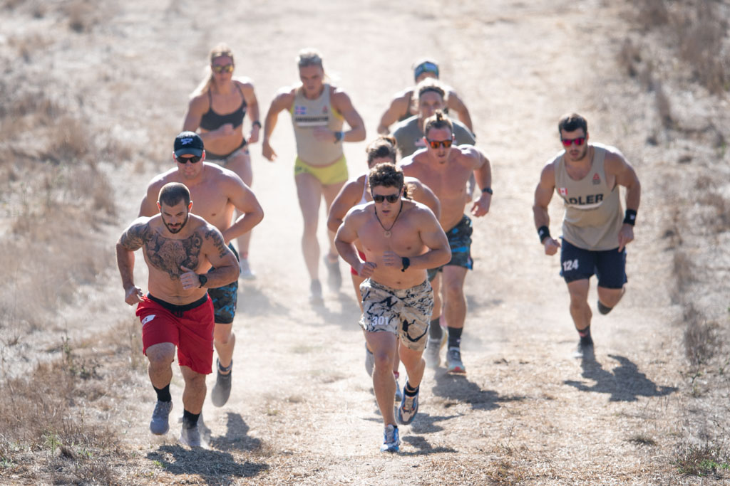 A group of athletes including Mat Fraser and Tia-Clair Toomey-Orr run at the 2020 CrossFit Games.