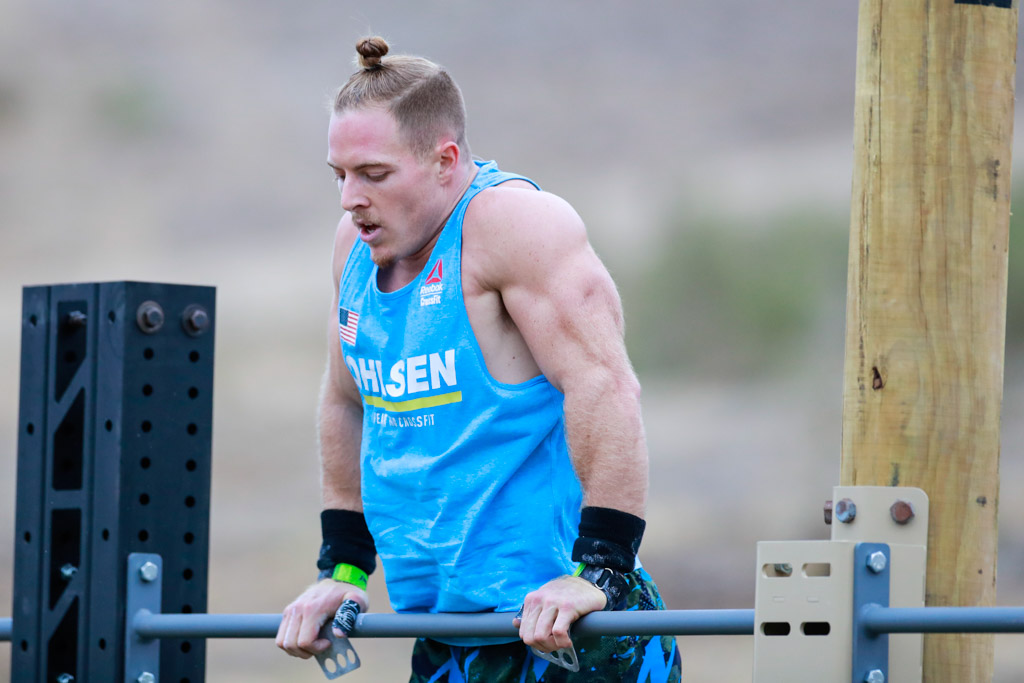 Noah Ohlsen at the top of a bar muscle-up at the 2020 CrossFit Games.