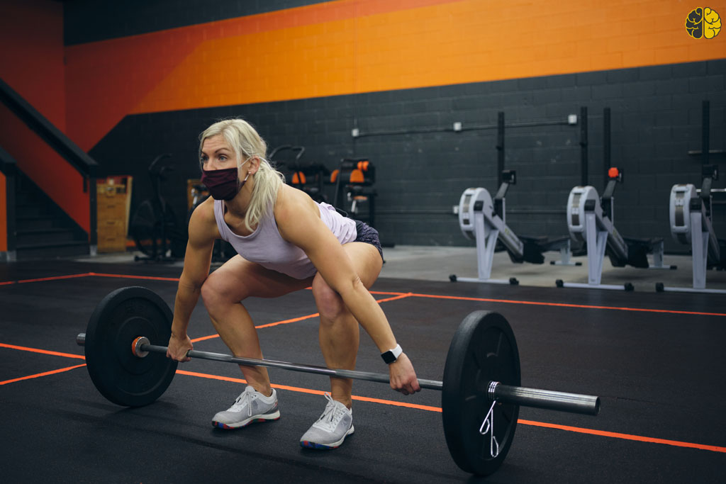 2021: The Best Time to Open a Microgym - a woman lifting weights