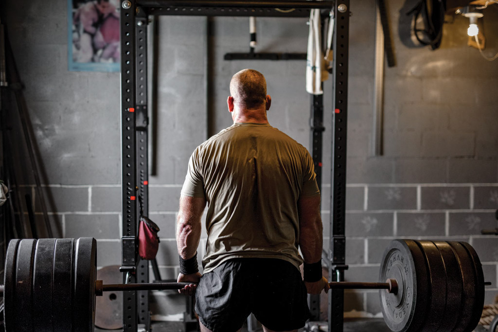 A shot as retired Navy SEAL Jocko Willink deadlifts about 400 lb.